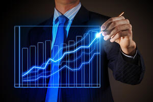 Closeup image of businessman drawing 3d graphics-1